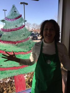 Barista Susan standing next to their EMPTY tree! Thank you to all the Starbucks customers in Golden Valley who participated in our Be A Santa to a Senior program!!!