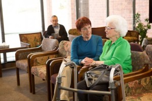 Family-caregiver-with-senior_clinic-waiting-room